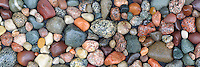 A close up panoramic of wet Lake Michigan rocks in a variety of bold colors and shapes that makes a good decorating neutral. A tranquil nature and environmental image for home and office decor. Available in 20x60 and 12x36 gallery wrapped canvas.