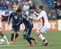 Sporting Kansas City midfielder Benny Feilhaber (10) dribbles as New England Revolution defender Kelyn Rowe (11) closes.  In a Major League Soccer (MLS) match, Sporting Kansas City (blue) tied the New England Revolution (white), 0-0, at Gillette Stadium on March 23, 2013.