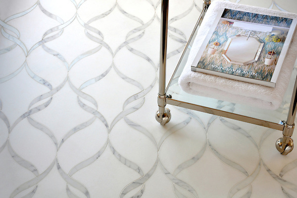 Sophie, a handmade mosaic shown in polished waterjet-cut Calacatta Tia and honed Thassos, is part of the Silk Road Collection by Sara Baldwin for New Ravenna.<br /> <br /> For pricing samples and design help, click here: http://www.newravenna.com/showrooms/