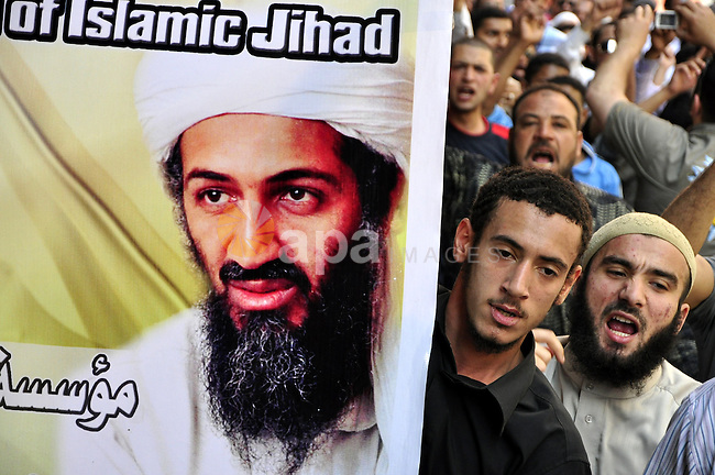 Egyptian Islamist groups hold a picture of Osama bin Laden, during a protest outside the U.S. embassy in Cairo, Egypt, Friday, May 6, 2011. Al-Qaida on Friday confirmed the killing of Osama bin Laden and warned of retaliation, saying Americans' 'happiness will turn to sadness. Photo by Ahmed Asad