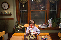 Erin Ouverson, age 6, drinks a rootbeer float on Sunday, December 4, 2011 in Webster City, IA.