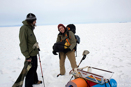 Misha (left) and his wife Nastya start their trek across frozen Lake Baikal in Siberia, Russia. .They are a group of five people: Justin Jin (Chinese-British), Heleen van Geest (Dutch), Nastya and Misha Martynov (Russian) and their Russian guide Arkady. .They pulled their sledges 80 km across the world's deepest lake, taking a break on Olkhon Island. They slept two nights on the ice in -15c. .Baikal, the world's largest lake by volume, contains one-fifth of the earth's fresh water and plunges to a depth of 1,637 metres..The lake is frozen from November to April, allowing people to cross by cars and lorries.