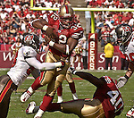 Tampa Bay Buccaneers linebacker Shelton Quarles (53) tackles San Francisco 49ers running back Kevan Barlow (32) after long run on Sunday, October 19, 2003, in San Francisco, California. The 49ers defeated the Buccaneers 24-7.