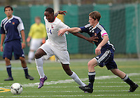 HYATTSVILLE, MD - OCTOBER 26, 2012:  Alfonce Mutuku (14) of DeMatha Catholic High School gets away from Nate Johnson (19) of St. Albans during a match at Heurich Field in Hyattsville, MD. on October 26. DeMatha won 2-0.