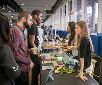 Job seekers speak with Mogul employees at the TechDay New York event on Thursday, April 23, 2015. Thousands attended to seek jobs with the startups and to network with their peers. TechDay bills itself as the world's largest startup event with over 300 exhibitors. (© Richard B. Levine)