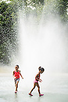 WATERBURY, CT- 8 September 2015-090815EC02-  Jolliana Vasquez, 6, (left) and her sister, Victoria Vasquez, 4, cool off in the splash pad Tuesday at Waterville Park in Waterbury. The children had early dismissal from school as temperatures reached around 95 in the city. Erin Covey Republican-American