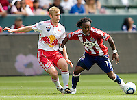 Chivas USA forward Chukwudi Chijindu (77) attempts to move around New York Red Bulls defender Tim Ream (5). Chivas USA defeated the Red Bulls of New York 2-0 at Home Depot Center stadium in Carson, California April 10, 2010.  .