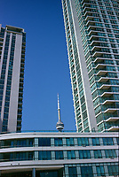 Condominiums on Yonge street and the CN Tower<br /> <br /> The CN Tower, located in Toronto, Ontario, Canada, is the world's tallest freestanding structure on land, standing 553.33 meters (1,815 ft 5 in) tall. It is considered the signature icon of the city, attracting more than two million international visitors annually<br /> <br /> Photo : Pierre Roussel - Images Distribution