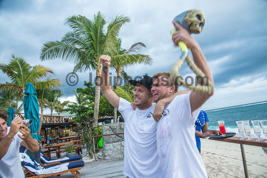 Namotu Island Resort, Nadi, Fiji (Monday, June 6 2016): Taj Burrow (AUS) nad Jack Freestone (AUS) - The Fiji Pro, stop No. 5 of 11 on the 2016  WSL Championship Tour, witnessed heated head-to-head match-ups as the world's best surfers fought through elimination Round 2 in four-to-six foot (1 - 2 metre) waves at Cloudbreak. Round Two was completed with the new longer period swell from the West slowly dropping during the day.  The contest was looking at a number of lay-days due to the  dropping swell so it gave the surfers on Namotu a chance to celebrate Taj Burrow's birthday and his retirement.  Photo: joliphotos.com
