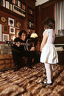 """March 1, 1971 - New Jersey. Paul Anka and daughters at home. Paul Anka (b. July 30, 1941) is a Canadian singer, songwriter and actor who became famous with the hit songs """"Diana"""", """"Lonely Boy"""" and """"Put Your Head on My Shoulder"""", as well as famously wrote the well-known theme music for The Tonight Show Starring Johnny Carson and one of Tom Jones's biggest hits, """"She's a Lady""""."""