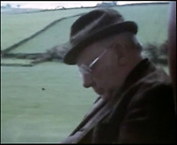 BNPS.co.uk (01202 558833)<br /> Pic: FrankWilliams/BNPS<br /> <br /> ****must use full byline****<br /> <br /> Screen grab of Arthur Lowe who plays Captain Mainwaring sleeping on the coach.<br /> <br /> Never-seen-before film of the cast of Dad's Army behind the scenes has emerged to show Private Pike wasn't such a 'stupid boy' after all.The home movie footage captures actor Ian Lavender doing the Times crossword as he prepares to face the audience during the stage version of the classic BBC comedy.Dressed in his Home Guard uniform and with his trademark maroon scarf draped around his neck, the young actor is seen puffing on a cigarette with the paper on his lap.Although his character Pvt Frank Pike was a simple mother's boy, actor Ian was known to be the most intelligent member of the cast.