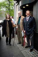 MAUD ADAMS, CHRISTOPHER LEE & SIR ROGER MOORE .Having a Bond reunion lunch at The Ivy Club this afternoon, London, England..April 26th, 2010.full length blue suit jacket grey gray trousers umbrella married husband wife cane beige green brown black leopard print scarf.CAP/DYL.©Dylan/Capital Pictures.