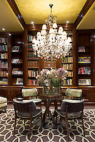 Ornate glass chandelier in elegant library in Hotel Estherea one of the luxury hotels in Singel, Amsterdam, Holland, The Netherlands