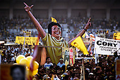 Manila, Philippines<br /> February 1986<br /> <br /> Corazon Aquino campaigning for President of the Philippines in 1986.<br /> <br /> Corazon Aquino was born into one of the wealthiest families in the Philippines, Mrs. Aquino began her political education by playing the dutiful wife as the political career of her husband, Benigno Aquino Jr., expanded. In less than 20 years he emerged as one of the chief potential rivals of Mr. Marcos, who was then president. When Mr. Marcos declared martial law in 1972, her husband was arrested and imprisoned for seven years. He was assassinated in 1983 after returning to the Philippines from a three-year exile in the United States. Mr. Marcos was widely blamed for the murder. It was at Mr. Aquino's funeral that Mrs. Aquino, became a national symbol, demonstrating the dignity and composure that would characterize her most difficult moments as president. <br /> <br /> Mrs. Aquino came to power through what amounted to popular acclaim -- what the Philippino people called &quot;people power&quot; -- expressed by huge crowds that gathered in support of her. Her popularity reached its peak during her presidential campaign against Mr. Marcos in January 1986, when she was surrounded by enthusiastic crowds chanting, &quot;Cory! Cory! Cory!'&quot;<br /> <br /> Her act of knocking down a dictator and bringing democracy to the Philippines was a high point in the country's modern history, and it offered a model for nonviolent uprisings that has been repeated often in other countries...Mrs. Aquino, was often criticized as an indecisive and ineffectual leader. But she combined passivity and stubbornness and an unexpected shrewdness to hold firm against powerful opponents from both the right and the left, and one of her greatest accomplishments as president was fending off a half dozen coup attempts. <br /> <br /> The restoration of democracy, and the transition to a new president, were Mrs. Aquino's prime legacies. Yet she led demonstrations against all 3 of her successors.<br /> <br /> She died on July 31, 2009.
