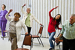 Occupational Therapy students participate in a pilates class with local residents at the Medford Senior Center. (Alonso Nichols/Tufts University)