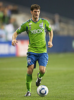 Seattle Sounders FC forward Brad Evans dribbles the ball during play against Toronto FC at Qwest Field in Seattle Saturday April 30, 2011. The Sounders won the game 3-0.
