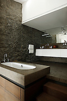 "The bathroom walls are clad in an unusual Portuguese stone called ""Armorican Blue"""