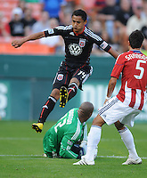 Chivas USA goalkeeper Zach Thornton (22) goes down to save the play against DC United midfielder Andy Najar (14).  DC United defeated Chivas USA 3-2 at RFK Stadium, Saturday May 29, 2010.