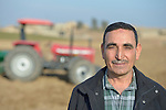Sabah Ibrahim, a farmer displaced by the Islamic State group in 2014, stands in a field outside Sindana, Iraq. Ibrahim is a Christian and he's working the land of a Muslim to earn income until he can go home. He received some farm  machinery and the necessary training in a livelihood program sponsored by the Christian Aid Program Nohadra - Iraq (CAPNI).