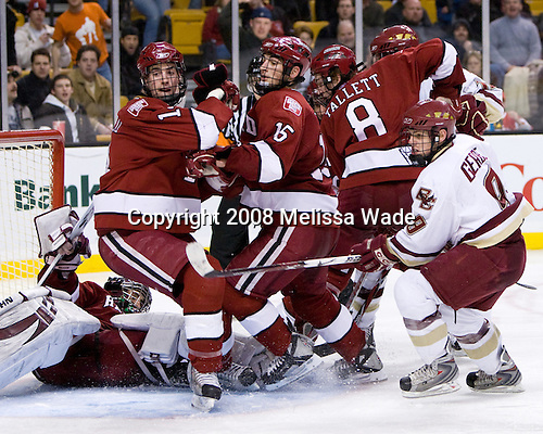 David MacDonald (Harvard 14), Doug Rogers (Harvard 15) and Ian Tallett (Harvard 8) battle with Ben Smith (BC 12) and Nate Gerbe (BC 9) in front of Kyle Richter (Harvard 33). The Boston College Eagles defeated the Harvard University Crimson 6-5 in overtime on Monday, February 11, 2008, to win the 2008 Beanpot at the TD Banknorth Garden in Boston, Massachusetts.