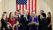 United States Vice President Joe Biden, with his wife Jill Biden holding the Biden Family Bible, takes the oath of office from Supreme Court Justice Sonia Sotomayor surrounded by family during an official ceremony at the Naval Observatory, Sunday, Jan. 20, 2013, in Washington. Family members from left: Maisy Biden, R. Hunter Biden, Noami Biden, Finnegan Biden, Natalie Biden, Kathleen Biden, Hunter Biden, Ashley Biden, Howard Krein, Beau Biden, Hallie Biden..Credit: Carolyn Kaster / Pool via CNP