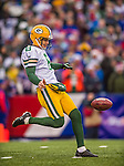 14 December 2014: Green Bay Packers punter Tim Masthay kicks in the first quarter against the Buffalo Bills at Ralph Wilson Stadium in Orchard Park, NY. The Bills defeated the Packers 21-13, snapping the Packers' 5-game winning streak and keeping the Bills' 2014 playoff hopes alive. Mandatory Credit: Ed Wolfstein Photo *** RAW (NEF) Image File Available ***