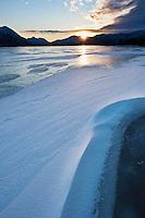 Winter sunrise on frozen lake Urvatnet, Lofoten Islands, Norway
