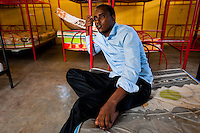 A young Somali immigrant, heading to the southern U.S. border, waits in the detention center in Metetí, Darién, Panama, 31 January 2015.