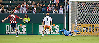 CARSON, CA – July 23, 2011: Chivas USA forward Justin Braun (17) scores his first goal of the night past Houston Dynamo goalie Tally Hall (1) during the match between Chivas USA and Houston Dynamo at the Home Depot Center in Carson, California. Final score Chivas USA 3, Houston Dynamo 0.