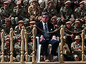 Coalition Provisional Authority Administrator L. Paul Bremer reviews the first battalion of New Iraqi Army (NIA) soldiers during their October 4, 2003 graduation ceremony at the Iraqi Army training center in Kirkush, Iraq. More than 700 soldiers comprising the first battalion of the NIA marched in formation in front of a small group of coalition dignataries and the Iraqi Governing Council President.