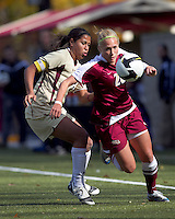 Florida State midfielder/forward Janice Cayman (20) receives pass and moves down wing as Boston College midfielder Chelsea Regan (2) defends. Florida State University defeated Boston College, 1-0, at Newton Soccer Field, Newton, MA on October 31, 2010.
