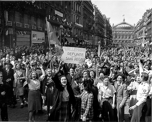 Paris, France - May 8, 1945 -- Cheering Parisians line the Avenue de L'Opera leading to the famous Opera House in the background as they celebrate the official announcement that the war in Europe is over in Paris, France on May 8, 1945..Credit: U.S. Army via CNP