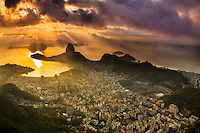 Rio de Janeiro cityscape, Brazil. Sugar Loaf, Botafogo beach and neighborhood seen from Corcovado at sunrise.