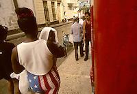 A woman wears American Flag shorts in Havana, Cuba in the late 1990s.