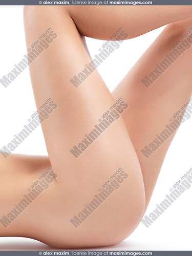 Nude woman bare legs, closeup of thighs with smooth skin isolated on white background