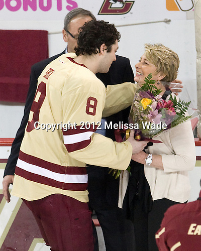 Edwin Shea (BC - 8), Ed Shea, Denise Shea - The Boston College Eagles defeated the University of Vermont Catamounts 4-0 on Saturday, March 3, 2012, at Kelley Rink/Conte Forum in Chestnut Hill, Massachusetts. The two points from the win gave BC the Hockey East regular season championship.