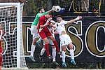 29 November 2015: Indiana's Grant Lillard (in red) is defended by Wake Forest's Alec Ferrell (left), Sam Raben (26), and Jon Bakero (ESP) (7). The Wake Forest University Demon Deacons hosted the Indiana University Hoosiers at Spry Stadium in Winston-Salem, North Carolina in a 2015 NCAA Division I Men's Soccer Tournament Third Round match. Wake Forest won the game 1-0.
