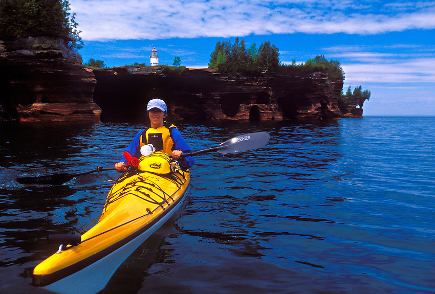 A sea kayaker on Lake Superior at the sea caves on Devils Island in Apostle Islands National Lakeshore near Bayfield, Wis.