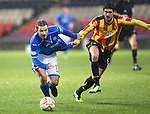 Partick Thistle v St Johnstone....14.12.13    SPFL<br /> Stevie May is pulled back by Gabriel Piccolo<br /> Picture by Graeme Hart.<br /> Copyright Perthshire Picture Agency<br /> Tel: 01738 623350  Mobile: 07990 594431