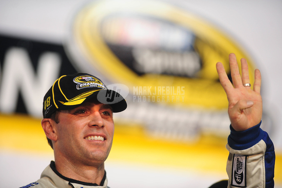 Nov. 22, 2009; Homestead, FL, USA; NASCAR Sprint Cup Series driver Jimmie Johnson after winning the 2009 Sprint Cup championship following the Ford 400 at Homestead Miami Speedway. Mandatory Credit: Mark J. Rebilas-