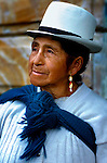 Panama hat and shawl distingushes this indigenous woman's ethnicity and tradtions in Cuenca, Ecuador.