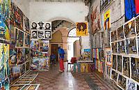Havana Cuba man in gallery at medina in Old Havana selling paintings artwork   4