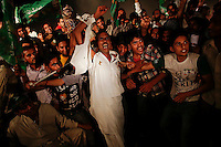 Supporters of the Pakistan Muslim League - Nawaz (PML-N) party react to the speech from the stage during a rally in Lahore May 9, 2013 ahead of Saturday's general elections. The polls, already Pakistan's most violent, will mark the first time a civilian government has completed a full term and handed over to another administration.   REUTERS/Damir Sagolj (PAKISTAN)