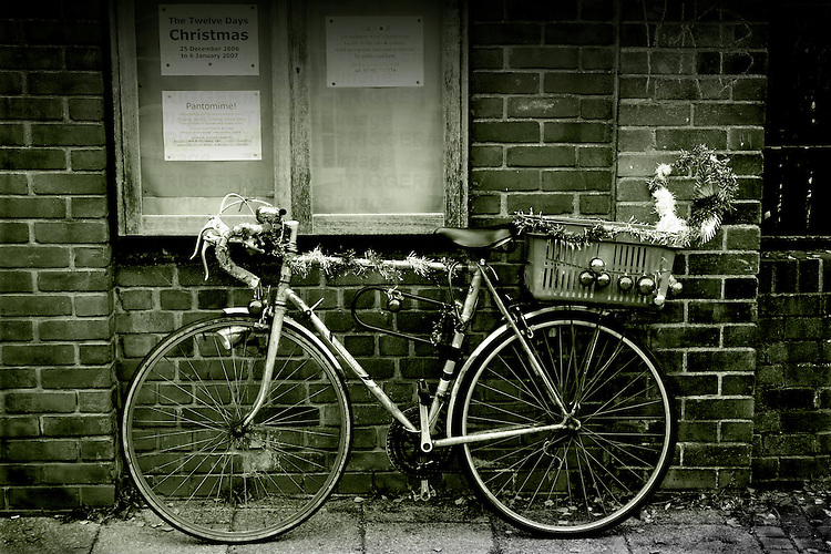 An old racing bike with Christmas decorations in Beccles, Suffolk, England