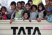 Indian children in back of TATA truck at Mehrauli, New Delhi, India