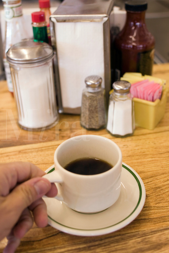 Cup of coffee on the bar of a diner, Bar BQ restauran