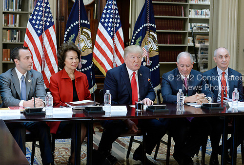 United States President Donald Trump speaks during a strategic and policy discussion with CEOs in the State Department Library in the Eisenhower Executive Office Building (EEOB) in Washington, DC, April 11, 2017.  Seated to the President's immediate right is US Secretary of Transportation Elaine Chao and to his immediate left is Stephen A. Schwarzman, CEO of the Blackstone Group.<br /> Credit: Olivier Douliery / Pool via CNP
