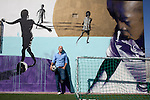 Khayelitsha, South Africa March 5, 2013: Amandla EduFootball founder Florian Zech on the field in Khayelitsha a poor township outside Cape Town, South Africa. They use football to initiate, support educational projects for youth in the township. The program keep children busy and it decreases the risk of them joining gang, criminal activity or teenage pregnancy. The crime level has decreased substantially in the area since the program was created in 2006. (Photo by: Per-Anders Pettersson)