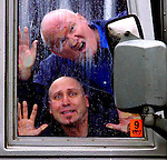 Boats Johnson and Art Krug clown around on a Grey Line bus in preparation of their comedic bus tour of Portland.