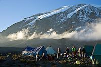 Climbing Kilimanjaro - Porters relax near their tents at the Karanga Valley camp at 4100 meters